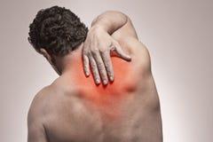 Baksida smärtar Arkivbild