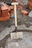 Baksteen en bouwhulpmiddelen Stock Foto's