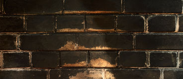 Bakstenen muur Bakstenenachtergrond Roetige bakstenen Royalty-vrije Stock Foto