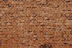 Bakstenen muur horizontale achtergrond met rode, oranje en bruine bakstenen Royalty-vrije Stock Foto's