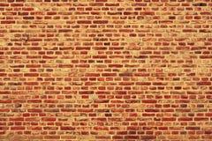Bakstenen muur horizontale achtergrond met rode, oranje en bruine bakstenen - oranje versie Stock Foto