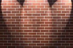 Bakstenen muur met Drie Schijnwerpers Royalty-vrije Stock Foto's