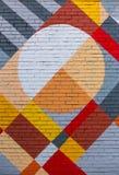 Bakstenen muur met een abstract geometrisch patroon Stock Fotografie
