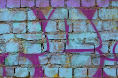 Bakstenen muur met graffiti Royalty-vrije Stock Foto