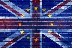 Bakstenen muur met het beeld van de vlag van de Europese Unie binnen de vlag van Groot-Brittannië Royalty-vrije Stock Afbeelding