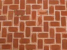 Bakstenen muur, Sinaasappel die de weg is Stock Foto's