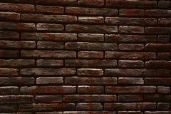 Bakstenen muur van donkere kleurenachtergrond Royalty-vrije Stock Afbeeldingen