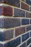 Bakstenen muur, voorraden, in rood en purples royalty-vrije stock afbeelding