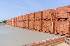 Bakstenen van de bouw de Concrete Bevloering Stock Afbeelding