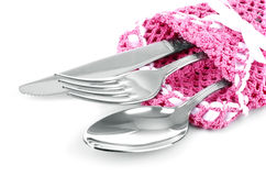 Baktala, dela sig och skeda på rosa färger den isolerade stack servetten Royaltyfri Bild