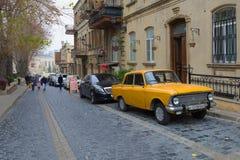 Soviet retro car `Izh Moskvich-412` in the street of the old city Baku. BAKU, AZERBAIJAN - DECEMBER 30, 2017: Soviet retro car `Izh Moskvich-412` in the street Royalty Free Stock Photo