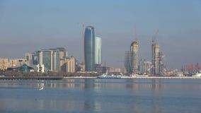 A sunny december day in the Baku Bay. Modern Baku, Azerbaijan. BAKU, AZERBAIJAN - DECEMBER 29, 2017: A sunny december day in the Baku Bay stock footage