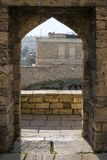 Entrance doorway in an ancient stone wall with a view of the panorama of the city. Royalty Free Stock Image