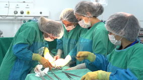 Baku, Azerbaijan-February 2016. Surgical team performing surgery operation, cesarean section. Caesarean section. Baku, Azerbaijan-February 2016. Surgical team stock video footage