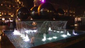 The fountain with spheres on the square on a January night. Baku, Azerbaijan. BAKU, AZERBAIJAN - JANUARY 04, 2018: The fountain with spheres on the square on a stock video