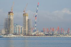 A view from the Caspian Sea of the construction of modern Baku. BAKU, AZERBAIJAN - JANUARY 04, 2018: A view from the Caspian Sea of the construction of modern royalty free stock images