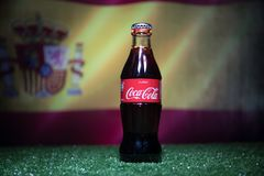 BAKU,AZERBAIJAN - JULY 01, 2018 : Creative concept. Coca-Cola Classic in a glass bottle on grass. Support your country in World cu. P 2018. Selective focus royalty free stock photo