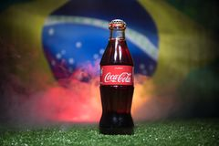 BAKU,AZERBAIJAN - JULY 01, 2018 : Creative concept. Coca-Cola Classic in a glass bottle on grass. Support your country in World cu. P 2018. Selective focus royalty free stock photography