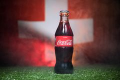 BAKU,AZERBAIJAN - JULY 01, 2018 : Creative concept. Coca-Cola Classic in a glass bottle on grass. Support your country in World cu. P 2018. Selective focus royalty free stock images