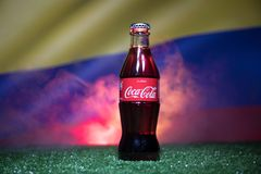 BAKU,AZERBAIJAN - JULY 01, 2018 : Creative concept. Coca-Cola Classic in a glass bottle on grass. Support your country in World cu. P 2018. Selective focus stock image