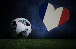 BAKU,AZERBAIJAN - JULY 08, 2018 : Creative concept. Official Russia 2018 World Cup football ball The Adidas Telstar 18 on green gr. Ass. Support France team royalty free stock images