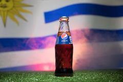 BAKU,AZERBAIJAN - JULY 01, 2018 : Creative concept. Pepsi Classic in a glass bottle on grass. Support your country in World cup 20. 18. Selective focus stock images