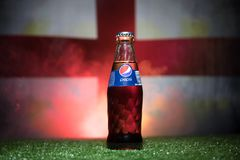 BAKU,AZERBAIJAN - JULY 01, 2018 : Creative concept. Pepsi Classic in a glass bottle on grass. Support your country in World cup 20. 18. Selective focus stock photos