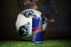 BAKU,AZERBAIJAN - JULY 01, 2018 : Official Russia 2018 World Cup football ball The Adidas Telstar 18 and Red Bull classic 250 ml c Royalty Free Stock Image