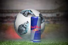 BAKU,AZERBAIJAN - JULY 01, 2018 : Official Russia 2018 World Cup football ball The Adidas Telstar 18 and Red Bull classic 250 ml c Stock Images