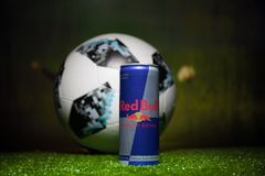 BAKU,AZERBAIJAN - JULY 01, 2018 : Official Russia 2018 World Cup football ball The Adidas Telstar 18 and Red Bull classic 250 ml c Stock Photography