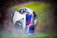 BAKU,AZERBAIJAN - JULY 01, 2018 : Official Russia 2018 World Cup football ball The Adidas Telstar 18 and Red Bull classic 250 ml c Stock Image