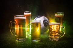BAKU,AZERBAIJAN - JUNE 23, 2018 : Creative concept. Official Russia 2018 World Cup football ball The Adidas Telstar 18 and Beer gl. Asses on green grass at dark stock photo