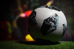 BAKU,AZERBAIJAN - JUNE 21, 2018 : Creative concept. Official Russia 2018 World Cup football ball The Adidas Telstar 18 on dark ton. Ed foggy background with royalty free stock image
