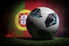 BAKU,AZERBAIJAN - JUNE 21, 2018 : Creative concept. Official Russia 2018 World Cup football ball The Adidas Telstar 18 on dark ton. Ed foggy background with flag Stock Photo