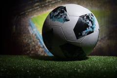 BAKU,AZERBAIJAN - JUNE 21, 2018 : Creative concept. Official Russia 2018 World Cup football ball The Adidas Telstar 18 on dark ton. Ed foggy background with Royalty Free Stock Image