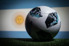 BAKU,AZERBAIJAN - JUNE 21, 2018 : Creative concept. Official Russia 2018 World Cup football ball The Adidas Telstar 18 on dark ton. Ed foggy background with flag Stock Images