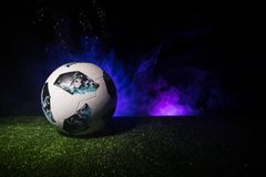 BAKU,AZERBAIJAN - JUNE 21, 2018 : Creative concept. Official Russia 2018 World Cup football ball The Adidas Telstar 18 on green gr. Ass with dark toned foggy stock image