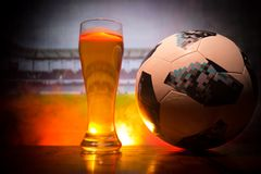 BAKU,AZERBAIJAN - JUNE 23, 2018 : Official Russia 2018 World Cup football ball The Adidas Telstar 18 and single beer glass at dark. BAKU,AZERBAIJAN - JUNE 23 Stock Photo