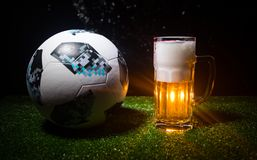 BAKU,AZERBAIJAN - JUNE 23, 2018 : Official Russia 2018 World Cup football ball The Adidas Telstar 18 and single beer glass on gree. BAKU,AZERBAIJAN - JUNE 23 Stock Images