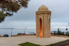 Shahidlar Monument or Eternal flame Monument on Martyrs` Lane in the evening. Baku. Azerbaijan. Baku, Azerbaijan - March 11, 2018: Shahidlar Monument or Eternal stock photography