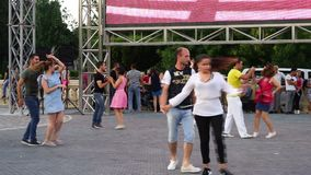 Baku, Azerbaijan - 27 May 2017: City Festival people enjoy dancing on street, crowd reiterate movements after dance stock video footage