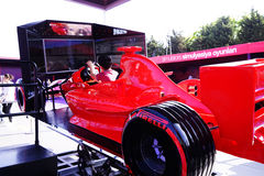 BAKU, AZERBAIJAN - MAY 17, 2016: Public race car Simulator on Ferrari F1 with large audience at Expo Tuning Baku is the Royalty Free Stock Photos