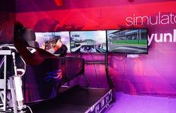 BAKU, AZERBAIJAN - MAY 17, 2016: Public race car Simulator on Ferrari F1 with large audience at Expo Tuning Baku is the Stock Photo
