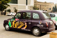 BAKU, AZERBAIJAN - OCTOBER 17, 2014: London style city taxi with 2015 first european games advertisement in Baku, Azerbaijan Stock Photo