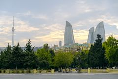 BAKU, AZERBAIJAN - OCTOBER 17, 2014: View of the Flame Towers skyscraper from caspian sea coastline in Baku on October 17, 2014. B Royalty Free Stock Image