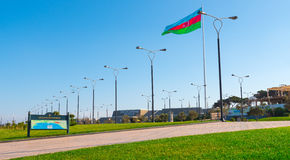 Baku bay embankment, National flag place. Huge flag of Azerbaijan Republic Stock Image