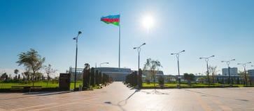 Baku bay embankment, National flag place. Sun and flag Stock Photos