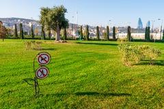 Baku bay embankment. Warning sign on the lawn Stock Images