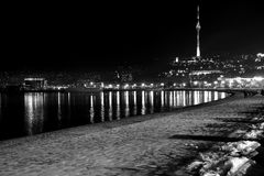 Baku Bulvar with snow at night, looking towards the Telecoms Tower, in the capital of Azerbaijan Royalty Free Stock Images