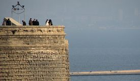 The Old Maiden Tower of Baku, Azerbaijan over the Caspian Sea royalty free stock photo